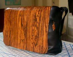 Woodgrain vinyl messenger bag