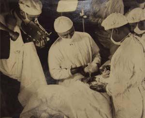 Photograph of Sarnoff performing an operation.