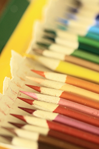 Photograph of an array of rainbow-colored pencils