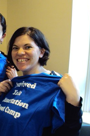 """Photo of me holding a T-shirt that says """"I survived Yale dissertation boot camp."""""""