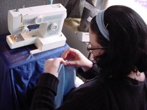 Photo of Miriam at her sewing machine