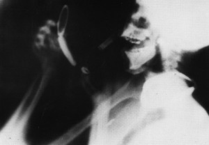 Still from Barbara Hammer's film, Sanctus, which shows an X-ray image of a head and torso in profile