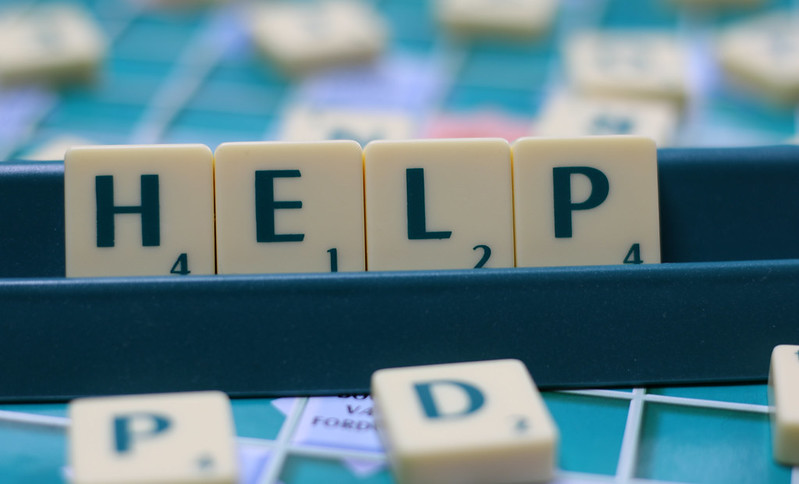"""Scrabble letter spell out """"help"""""""