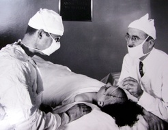 Freeman and Watts operate on a patient